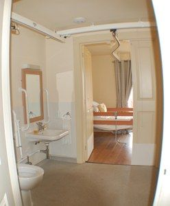 Bempton Holiday Villa, downstairs bathroom and bedroom showing overhead ceiling track hoist
