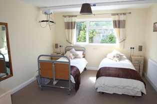 Phoenix Retreat, Braunton, N Devon. Bedroom with ceiling track hoist.